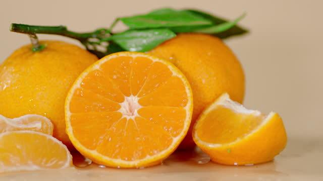 Sliced and whole Mandarin rotate slowly.