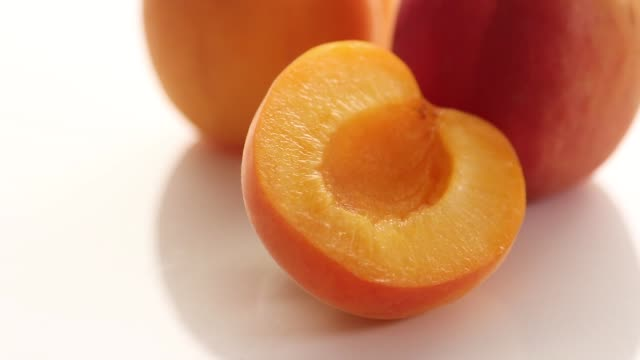 sliced apricots on white carriage - video