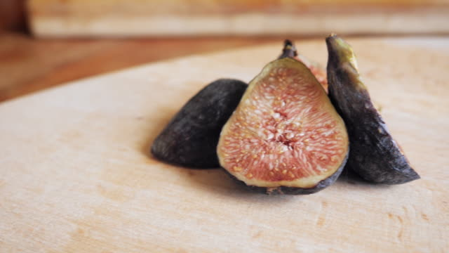 Sliced Fresh Figs on a Wooden Cutting Board - 4k video