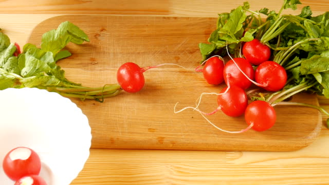 Sliced radish in the kitchen. Sliced radish in the kitchen. salad bowl stock videos & royalty-free footage