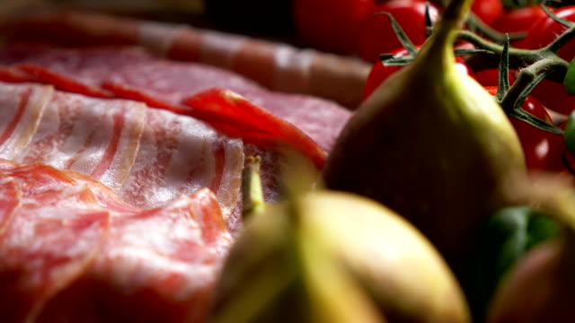Sliced slices of salami, tomato and fig video