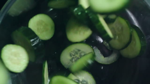 slices of cucumber - cetriolo video stock e b–roll