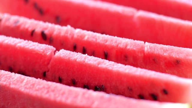 Slices of juicy watermelon Slices of juicy watermelon on a rotating plate watermelon stock videos & royalty-free footage