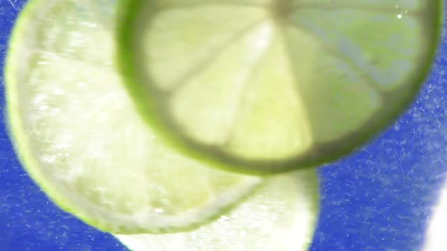 slices of lime close-up in water slices of lime in water closeup fresh summer drink tonic water stock videos & royalty-free footage