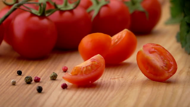 Slices of Ripe Tomato Falling on the Table. video