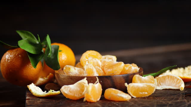 Slices of tangerine on the cutting Board slowly rotate.