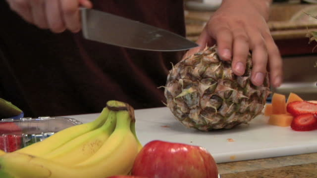 slicing a pineapple video