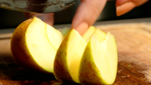 Slicing apples and pears for salad, cocktail or pie In the foreground cutting of apples and pears pear stock videos & royalty-free footage