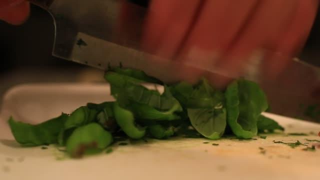 Slicing basil leaves. video