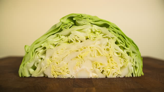 Slicing cabbage. Closeup of chopped vegetable on wooden cutting board. Stop motion animation Slicing cabbage. Closeup of chopped vegetable on wooden cutting board. Stop motion animation. cabbage stock videos & royalty-free footage