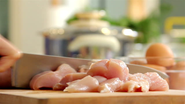 Slicing Raw Chicken Slicing Raw Chicken raw footage stock videos & royalty-free footage