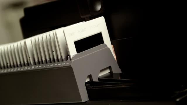 slide projector, show off your photos on film - diabild bildbanksvideor och videomaterial från bakom kulisserna