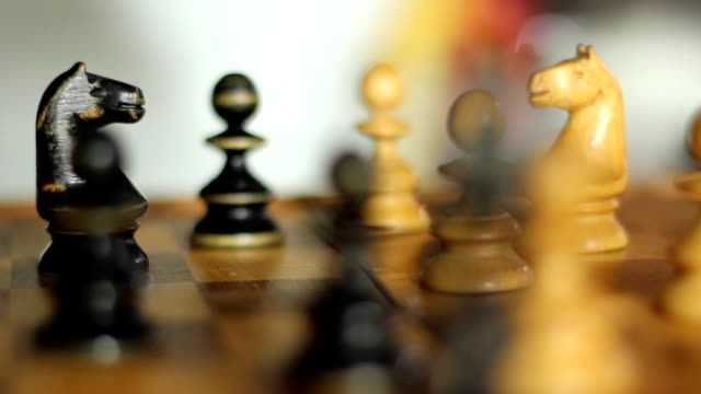 Slidecam on chess figures in a cozy flat environment video