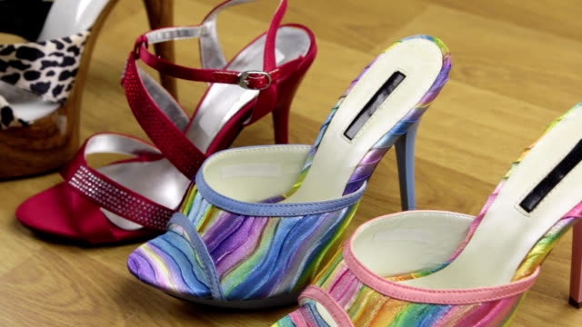 Slider shot. Many stylish classic women's sandals shoes with high heels.