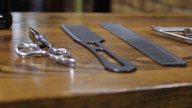 Slider shot of barber tools on wooden background video