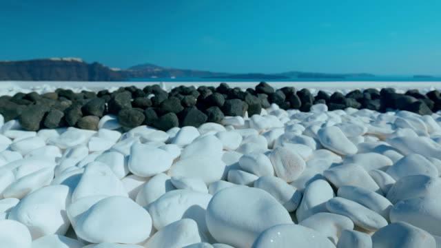 Slider Shot Showing Typical White and Black Pebbles on a Mediterranean Island video