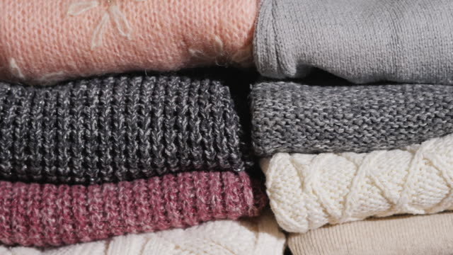 Slider video: Neatly folded winter clothes video