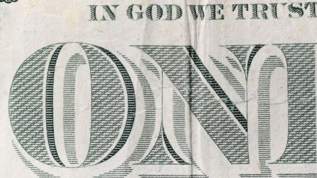 Sliding video of a one US dollar bill note, closeup video