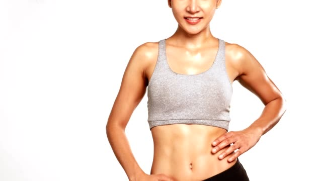 Slim perfect female body in sportswear on white background video