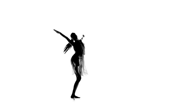Slim woman with ponytail dance modern contemporary style makes split on white, silhouette, slow motion video