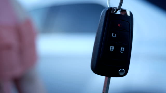 A Slimy Car Salesman hands the car keys to a young woman at car dealership A Slimy Car Salesman hands the car keys to a young woman at car dealership car salesperson stock videos & royalty-free footage