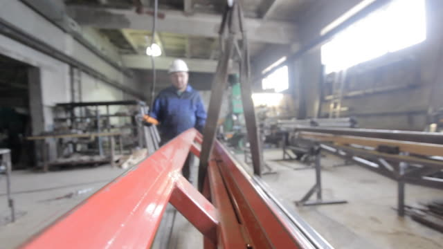 Sling operator works in a factory video
