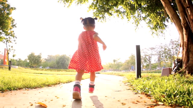 Slo Mo Baby Girls running during sunset in the park video