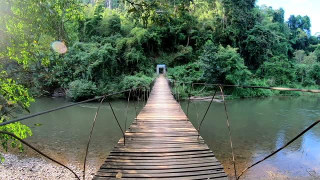 POV slo mo Crossing wooden bridge.