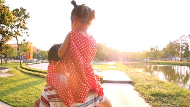 Slo Mo Father and Daughter walking in the park video
