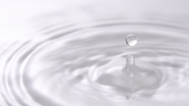 Slo mo of Water droplet on white water. Slo mo of Water droplet on white water. drop stock videos & royalty-free footage