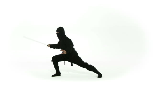 Slomo Ninja Poses Ninja assassing posing with a sword on a white background.  Two clips recorded in slow motion at 60fps. ninja stock videos & royalty-free footage