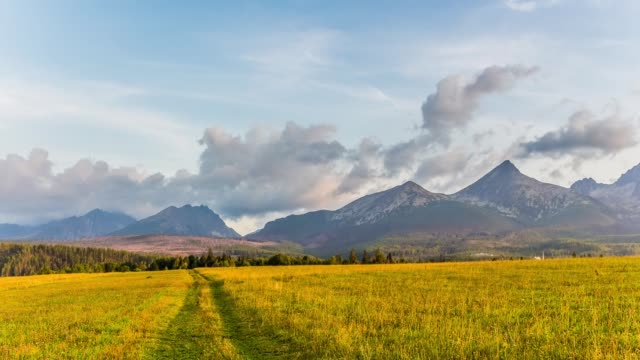 Slovakia - Tatra Mountains in the early morning. Timelapse - clouds over the mountains. video