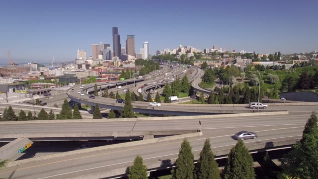 Slow Aerial Fly Over Downtown Seattle Freeway to Reveal Skyscraper Buildings in Skyline on Sunny Day video