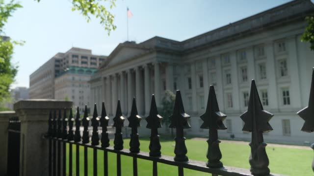 Slow Dolly Establishing Shot of Treasury Department Building WASHINGTON, D.C. - Circa August, 2017 - A slow dollying establishing shot of the US Treasury Department on Pennsylvania Avenue in DC. treasury stock videos & royalty-free footage