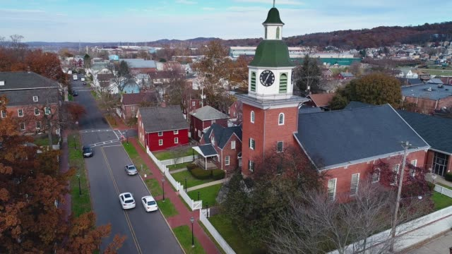 Slow Forward Aerial Establishing Shot of Small Town USA A slow forward aerial establishing shot of a small American town in the late Autumn. americana stock videos & royalty-free footage