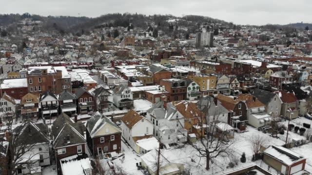 Slow Forward Aerial Establishing Shot of Small Village in Winter video
