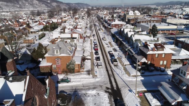Slow Forward Aerial View Small Rust Belt Town in Winter video