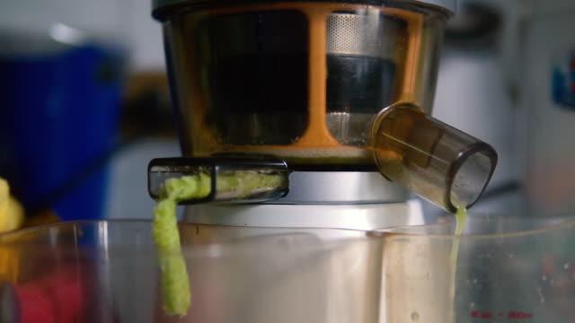 Slow juicer is making fresh Celery. Slow juicer is making fresh Celery. celery stock videos & royalty-free footage