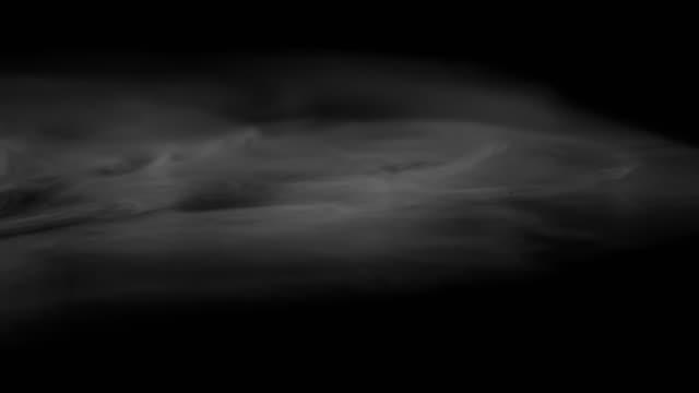 Slow Mist Flow Heavy white smoke slowly spreads over the black surface gradually dissolving heat haze stock videos & royalty-free footage