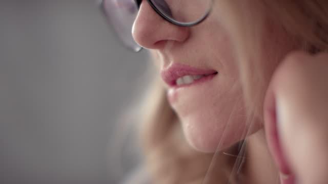 Slow Mo Close Up Young Woman Biting Lip