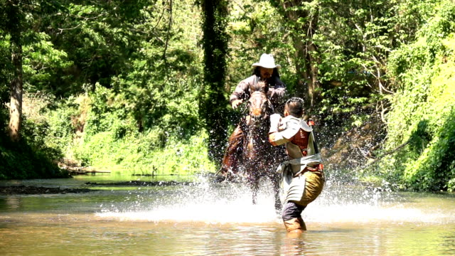 Slow Mo Cowboy Riding Horse And Jumping To Fight With Ancient Warrior