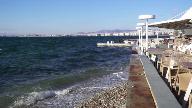 Slow mo empty cafe on the seashore in greece video