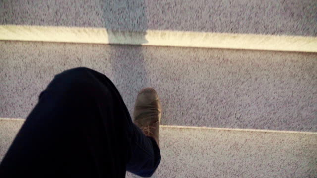 Slow mo: POV man foot on a stairs video