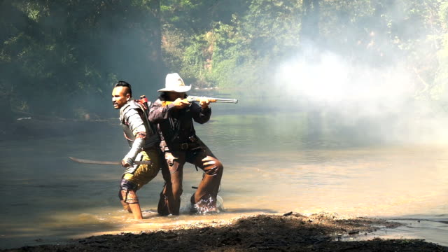 Slow Mo Of Ancient Warrior Fighting Together With Cowboy In The River