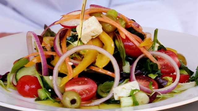 Slow motion 360 rotating shot of a colorful delicious fresh healthy salad video