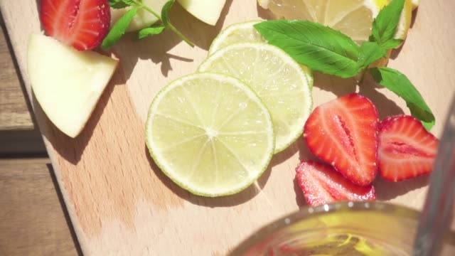 slow motion a refreshing fruit drink is poured into a glass - decanter video stock e b–roll