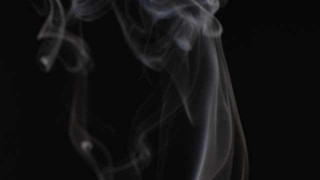 Slow motion abstract cigarette smoke background video