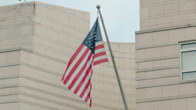 Slow Motion America's flag stars and stripes on the building of the US Embassy in Berlin, Germany. The concept of freedom and democracy
