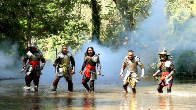 Slow Motion Ancient Warriors Preparing To Fighting At The River Super Slow Motion Shot Of Ancient Warriors Preparing To Fighting With Smoke At The River knight person stock videos & royalty-free footage