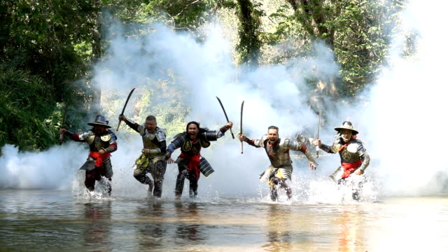 Slow Motion Ancient Warriors Running And Yelling To Fight With Enemy At The River Super Slow Motion Shot Of Five Ancient Warriors Running And Yelling To Fight With Enemy At The River knight person stock videos & royalty-free footage